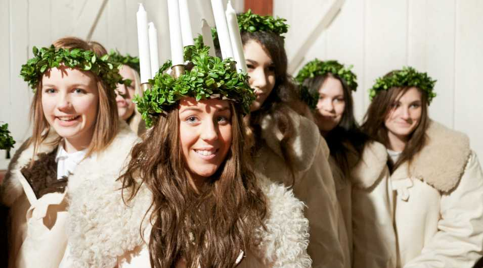 Saint Lucy's Day Sandviken, Sweden - December 11, 2011: Procession of girls on Saint Lucy's Day. A girl that is elected to... By: ferrantraite