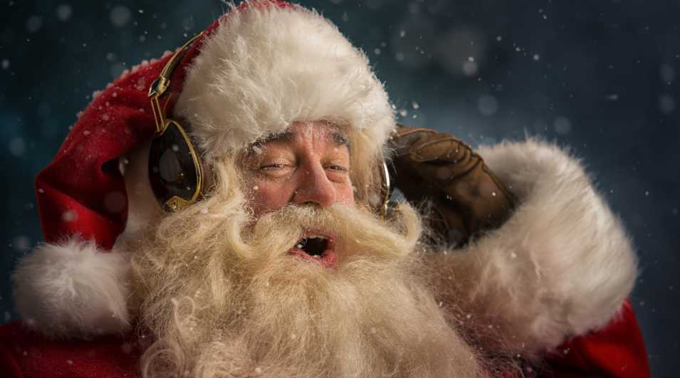 Santa Claus is listening music Santa Claus is listening to music in headphones wearing sunglasses. Christmas. By: HASLOO