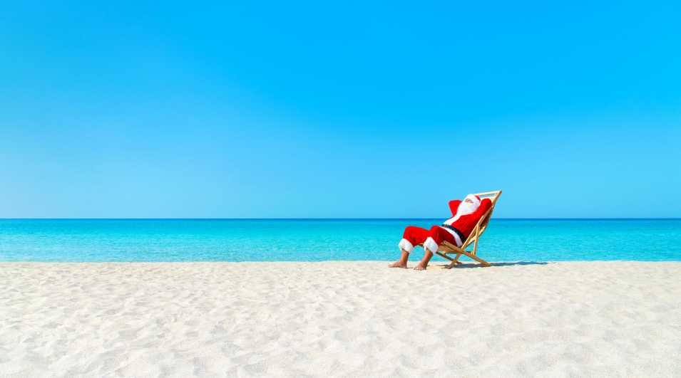 Christmas Santa Claus resting on deckchair at ocean sandy beach Christmas Santa Claus resting on deckchair at ocean sandy tropical beach... By: EM_prize